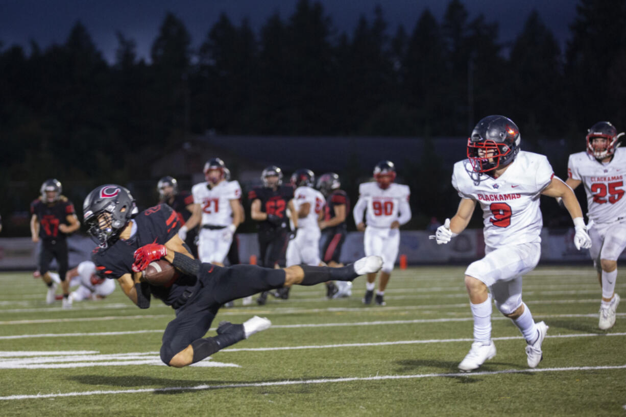 Papermakers Zach Blair makes a catch home opener game against thin the home opener against Clackamas at Doc Harris Stadium on Friday, September 10, 2021.