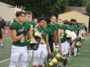 Evergreen players stand for the anthem prior to their game with Washougal on Friday, Sept.