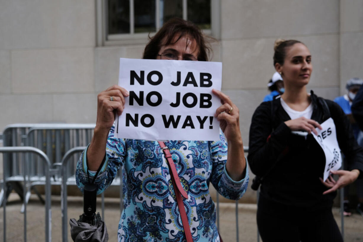 A small group of anti-vaccination protesters gather outside of New York-Presbyterian Hospital on September 1, 2021 in New York City.