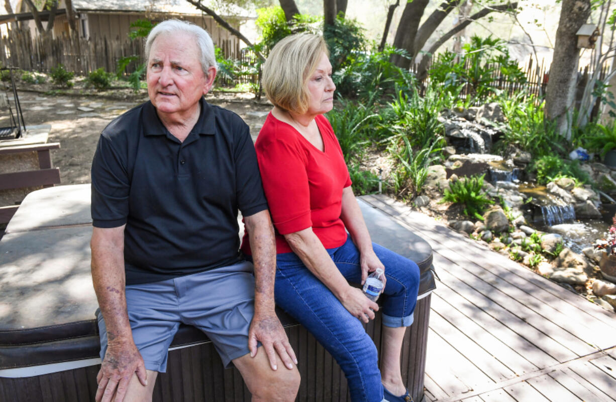 Dick and Diane Nichols in the backyard of their home in Prather, Calif., on August 25, 2021, a year after their former residence was destroyed in the Creek fire. It was the second time in five years their home was destroyed by fire.