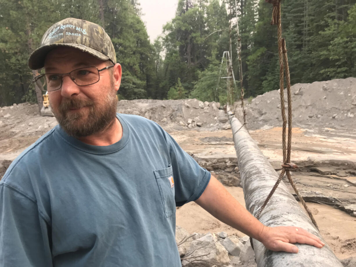 Richie Fesler, superintendent of public works for McCloud, a community of restored historic buildings on Shasta's southern flanks, is taking stock of progress made in an effort to remove tens of thousands of cubic yards of mud that nearly buried a suspended pipeline that supplied the area with spring water.
