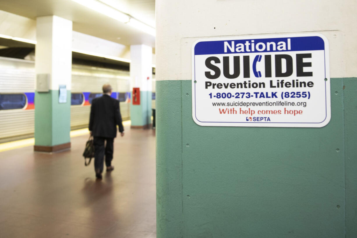 A sign for suicide prevention, photographed on the train platform at Suburban Station in Center City Philadelphia on Oct. 31, 2019.