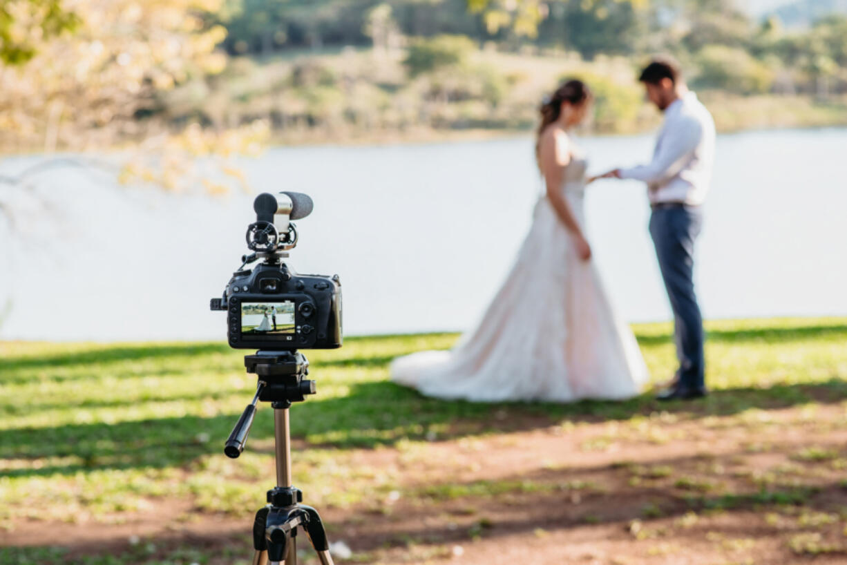 Filming Wedding Online - Social Distancing New Normal Concept live streaming - selective focus on the camera