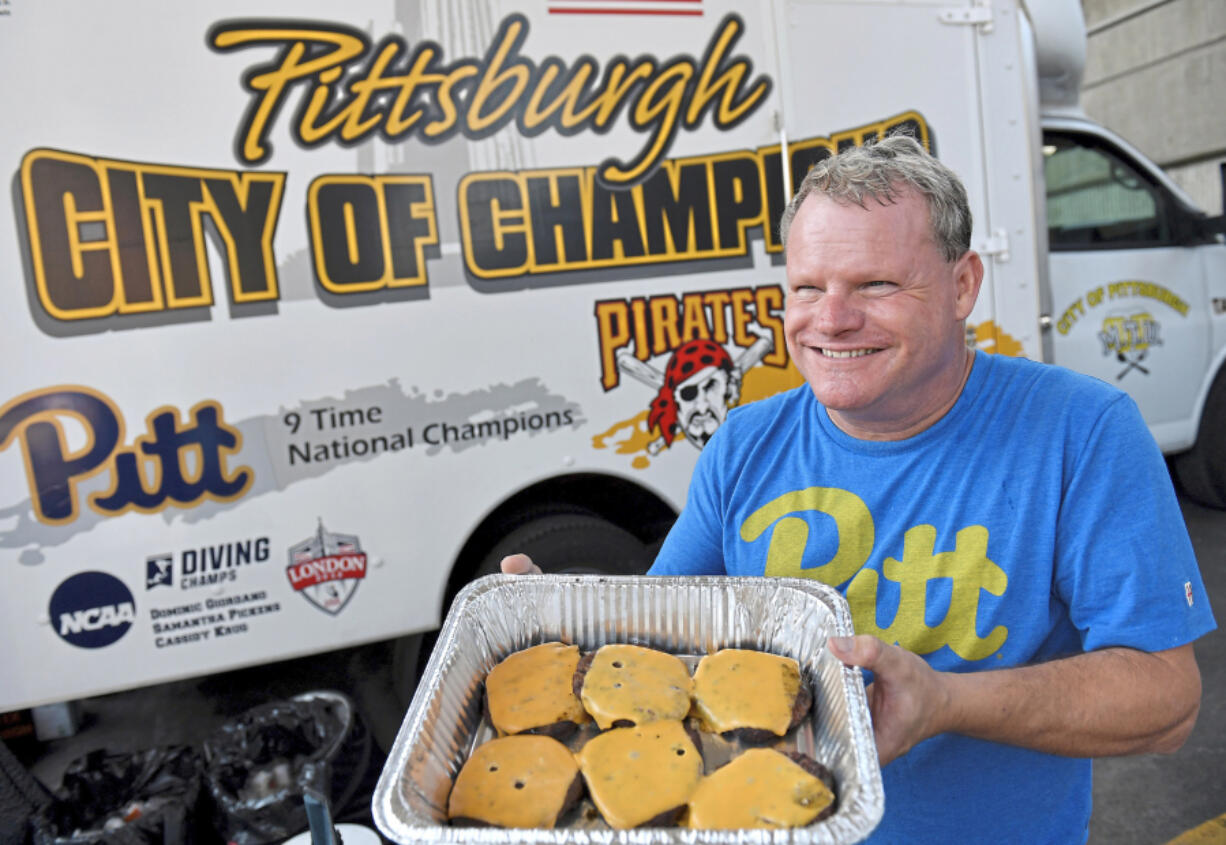 John Dusch displays his burgers Sept. 4 in front of his Mobile Tailgating Unit in the parking lot before Pitt takes on University of Massachusetts at Heinz Field in Pittsburgh.