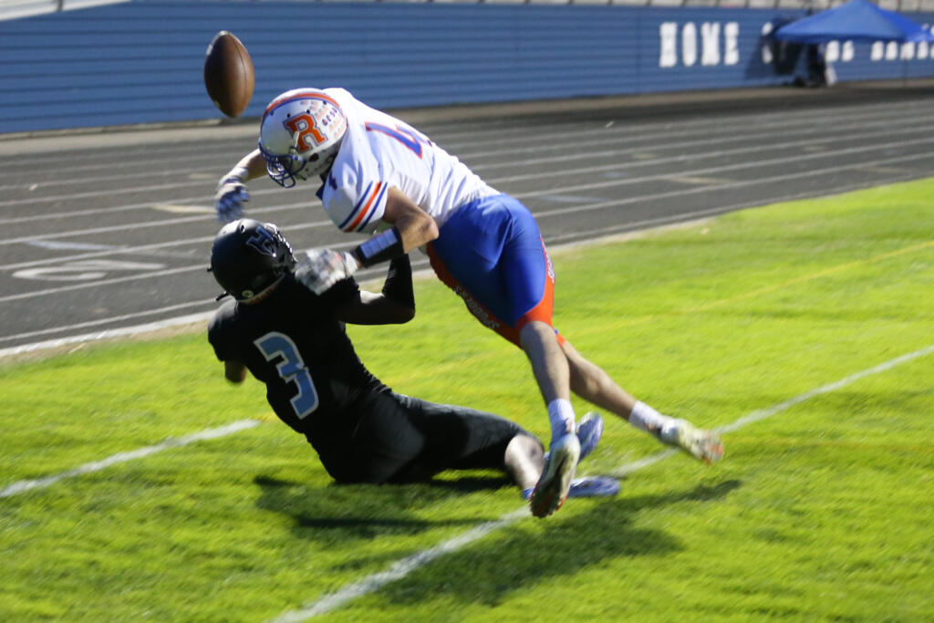 Ridgefield Spudders Ryan Jenkins (4) defends against a pass intended for Hockinson Hawks Kenyon Johnson (3) in first-half action in the 2A Greater St. Helens League season opener for both teams at Hockinson High School on Friday, Sept. 17, 2021. (Randy L.