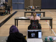 """Students work in the """"Internet Cafe"""" on Tuesday, Jan. 26, 2021, at Captain Strong Primary School in Battle Ground. Students are set up with Chromebooks in the gymnasium if they need internet to access remote learning."""