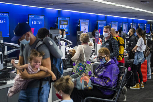 Amid a busy getaway travel day for the Memorial Day weekend and the first holiday since coronavirus pandemic restrictions have been relaxed, a crowd of travelers check in for their flights at Los Angeles International Airport at Delta Airlines, Terminal 2 at LAX on May 28, 2021. (Allen J.