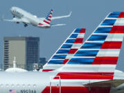 American Airlines will contribute $100 million to a new green technology fund spearheaded by Bill Gates and aimed at spurring research into technologies to lower carbon emissions. (Smiley N.