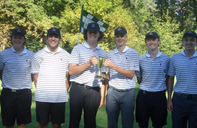 Easton Rheaume, left, and Eli Huntington hold the Titan Cup trophy after the Camas boys golf team won the Titan Cup four-team tournament Monday at Camas Meadows.