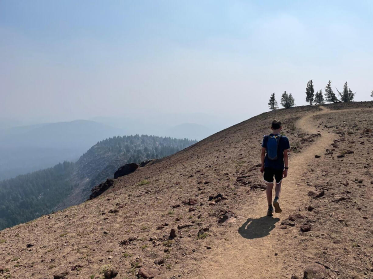 Mason Morical, 13, of Bend, Ore., walks across the summit of Tumalo Mountain on Sept. 5. When the air is clear, the alpine vistas atop the peak are tough to beat.