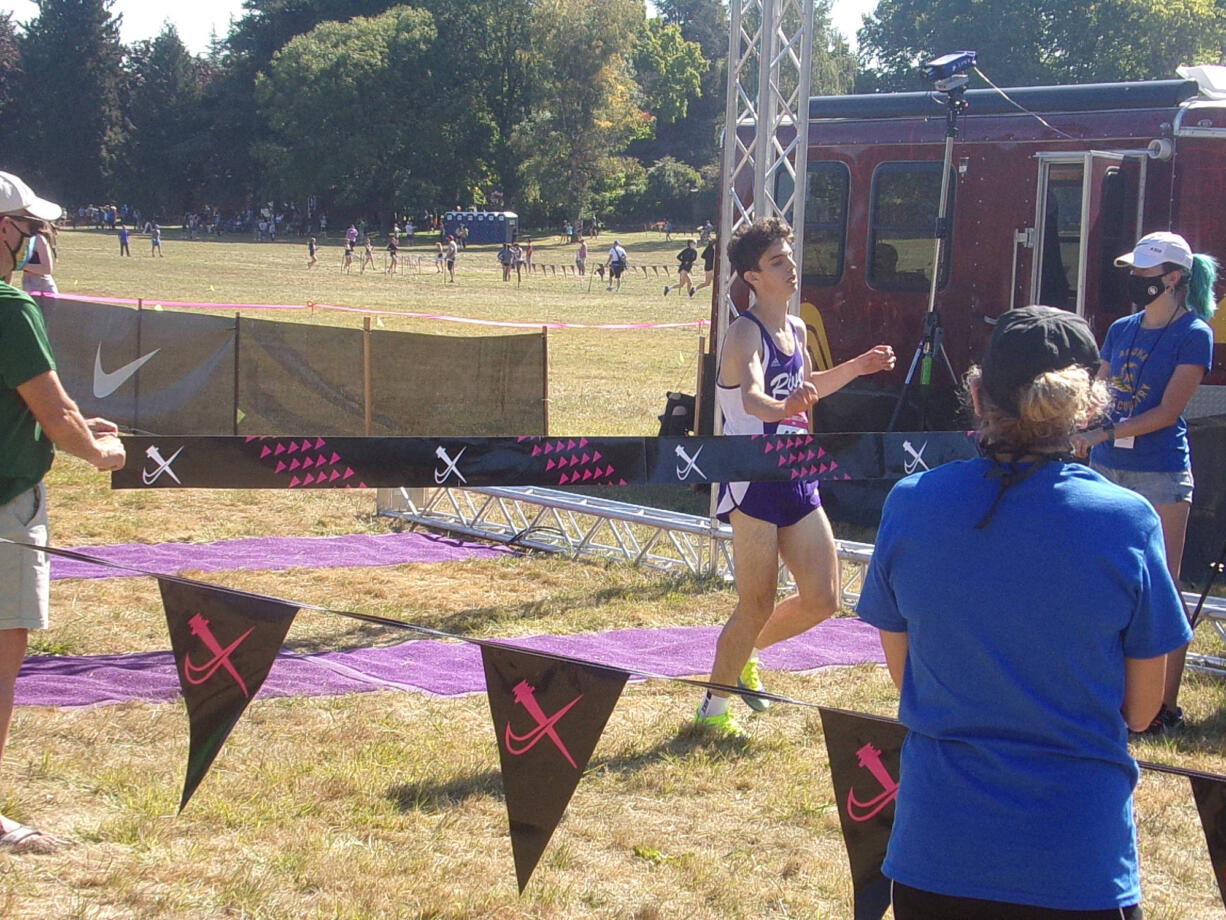 Columbia River's Daniel Barna breaks the finish tape after winning the Division I boys race at the Nike Portland XC meet on Saturday, Sept. 25, 2021 in Fairview, Ore.