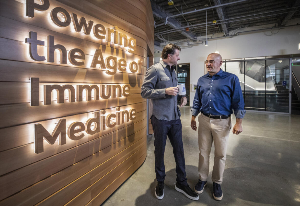 Chad Robins, CEO of Adaptive Biotechnologies and his brother and chief science officer, Harlan Robins in the entryway of their new facility they will soon be opening in Seattle, on September 17, 2021.