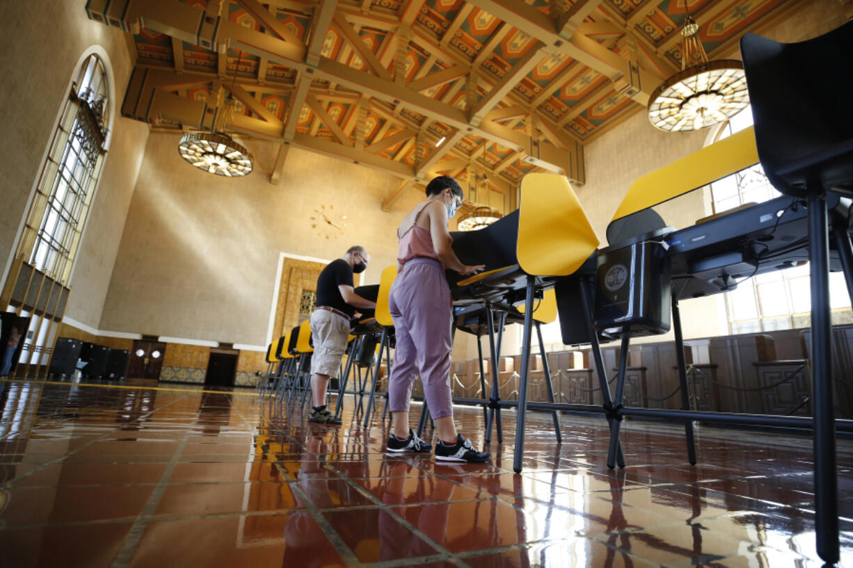 People cast their votes in California's recall election on Monday morning, Sept. 13, 2021, in the historic Los Angeles Union Station Ticket Hall or Main Concourse,  in Los Angeles.