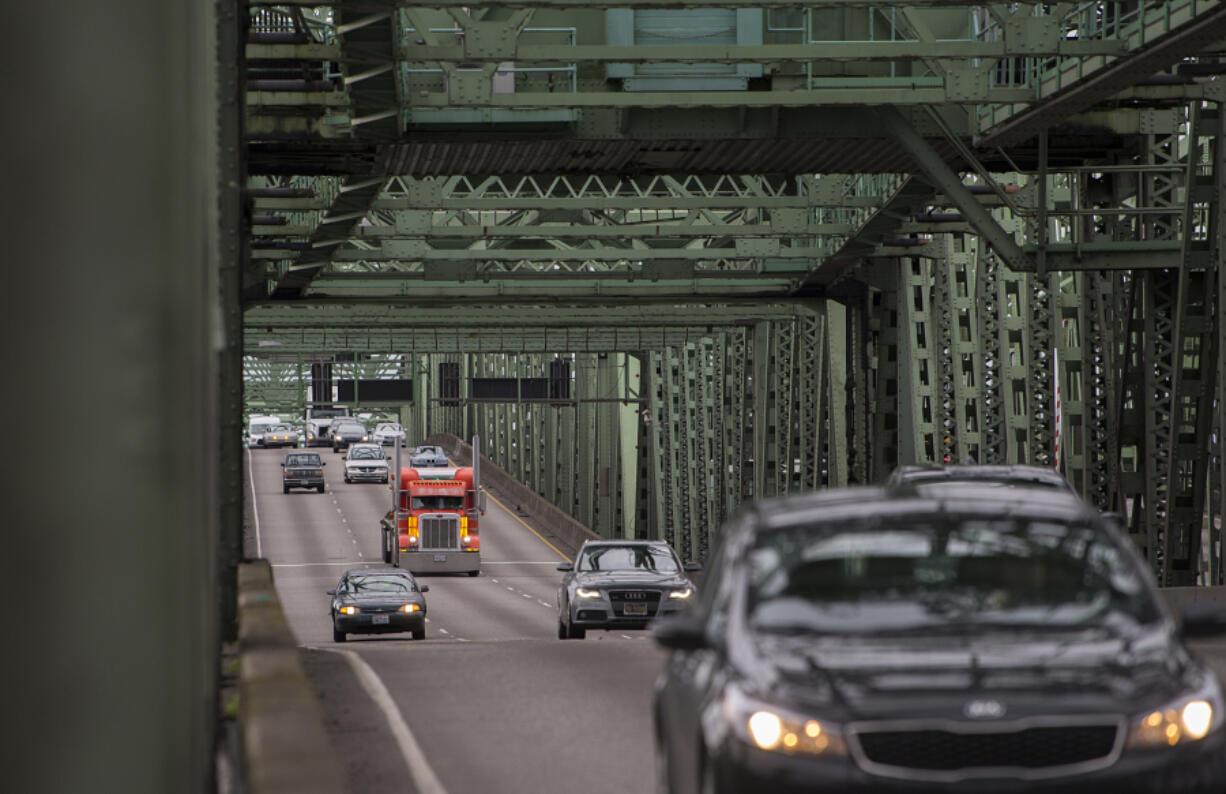 A truck joins other traffic crossing the Interstate 5 Bridge while traveling north on I-5 on Jan. 7, 2020. The Interstate Bridge Replacement Program office is aiming to settle on a single recommended configuration for a replacement bridge in January.