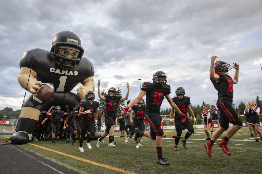 Papermakers enter the field for the Camas football home opener game against the Clackamas Cavaliers at Doc Harris Stadium on Friday, September 10, 2021.