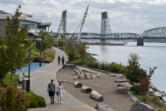 Amanda Cowan/The Columbian files Pedestrians stroll along America's 13th-best riverwalk, right here in Vancouver.
