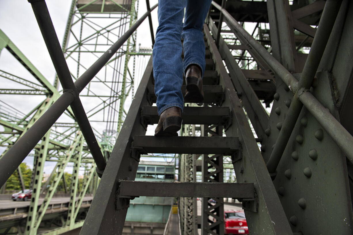 Marc Gross of the Oregon Department of Transportation climbs stairs as he gives a tour of the Interstate 5 Bridge on Aug.