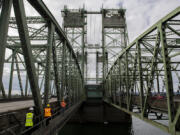 Visitors take a tour of the Interstate 5 Bridge. The older of the two spans opened in 1917, with the newer span following in 1958.