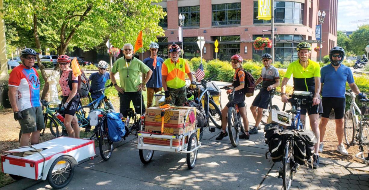 Members of the Vancouver Bike Club prepare to depart from the Vancouver Farmers Market withy a load of donated food bound for the Clark County food Bank. On most Sundays, club members gather at the downtown Vancouver event to pick up donations, which benefit the food bank and its partner agencies.