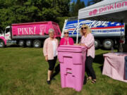Sherry Stose, left, Mary Frances Duggan and Jeanne Firstenburg with a pink Waste Connections recycling bin that supports the Pink Lemonade Project. A new pink Taylor Transport Inc. truck supporting the nonprofit made its debut at a recent cruise-in event at Alderbrook Park in Hockinson.