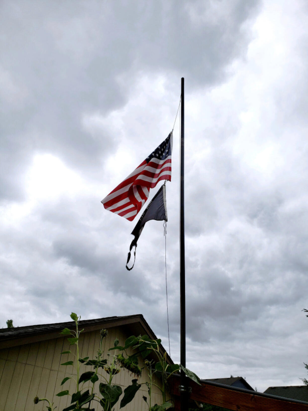 The U.S. flag is displayed at half staff on a home's flagpole recently following the Aug. 24 death of longtime Scouting volunteer Greg Hamilton at the age of 65.