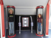 """Kirby, left, and Patricia Swatosh stand in """"freezing tubes"""" styled after those found in the TV show """"Lost in Space"""" on Monday in their UFO-themed Airbnb in Brush Prairie."""