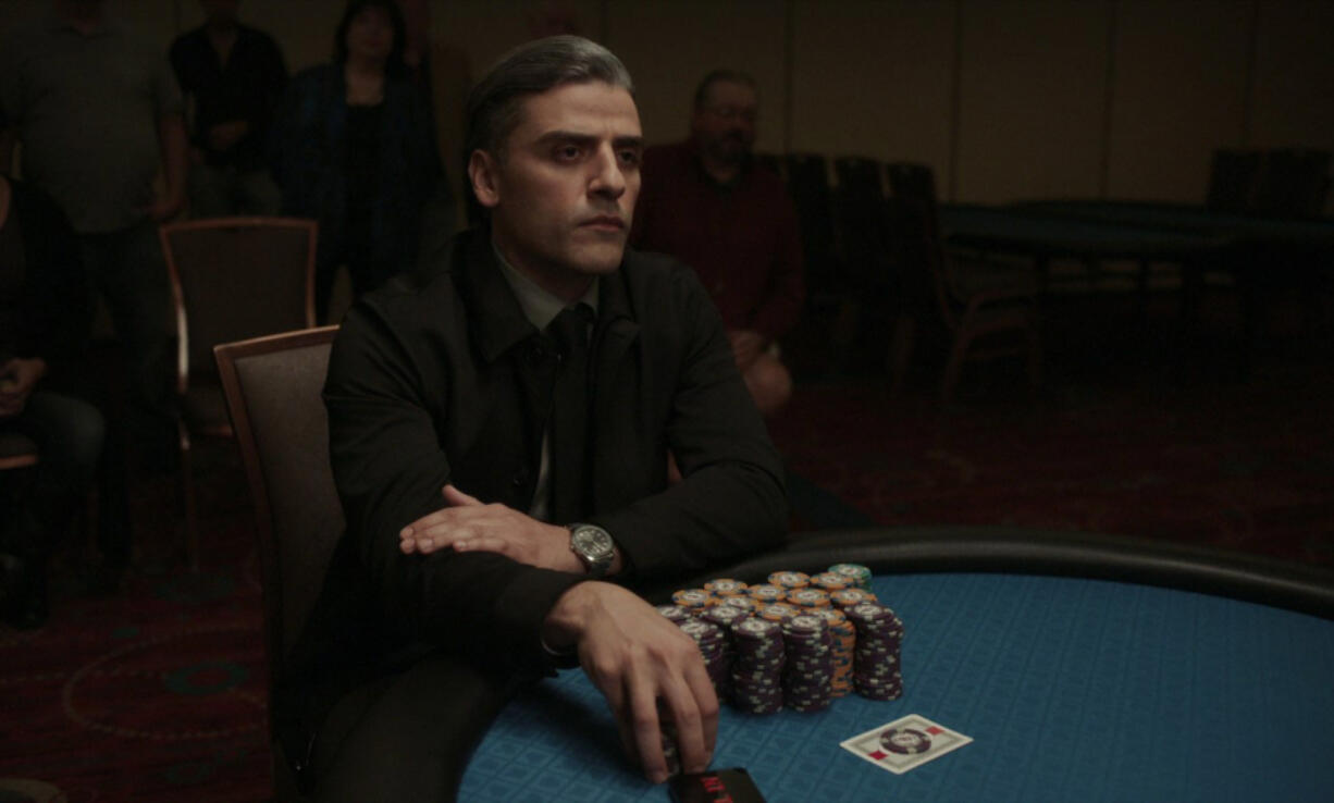 """Oscar Isaac plays a former solider who just wants to play cards -- but who winds up in big trouble -- in the new crime thriller """"The Card Counter."""" (Contributed by Focus Features)"""