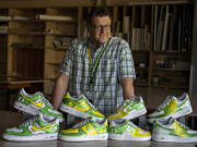 King's Way Christian Schools art teacher Justin Tigner, a professional sports artist, is traveling with the University of Oregon football team this fall as its game-day artist doing hand-painted shoe designs. Tigner also designs custom shoes and cleats for clientele including NFL players. He said he plans to blend two previous designs for custom shoes, a creation to be raffled off during Oregon football's alumni and donor tailgate Saturday at Ohio State.