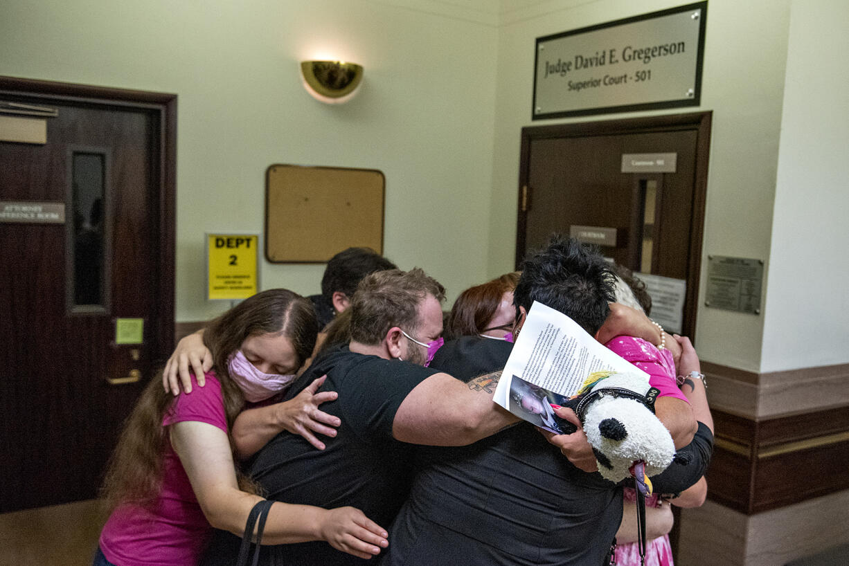 Family and supporters of slain transgender teen Nikki Kuhnhausen embrace Thursday morning, Sept. 9, 2021, after the sentencing of defendant David Bogdanov at the Clark County Courthouse. Bogdanov was sentenced to nearly 20 years in prison for the murder.