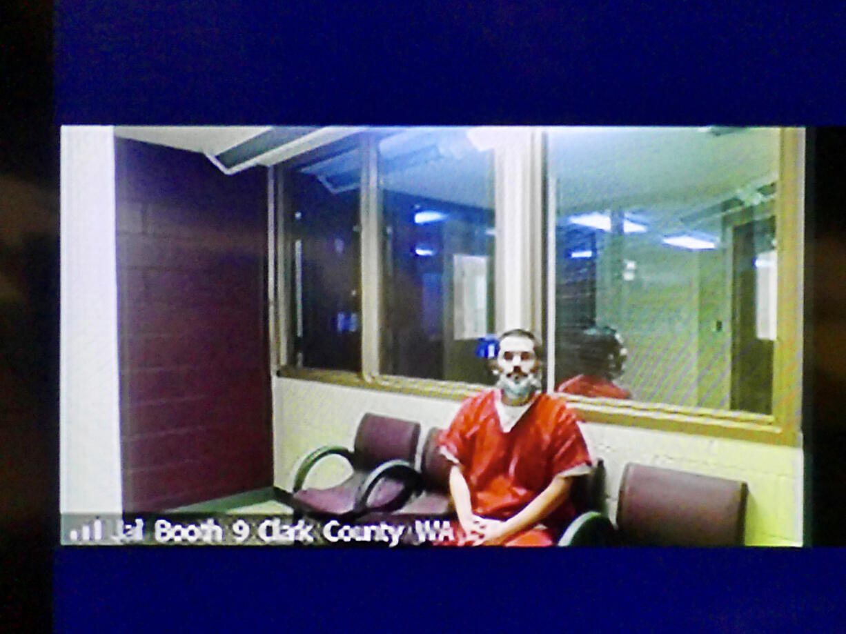 Guillermo Raya Leon appears Thursday via video in Clark County Superior Court to be arraigned on charges of first-degree aggravated murder and possession of a stolen firearm. He entered not-guilty pleas to both counts.