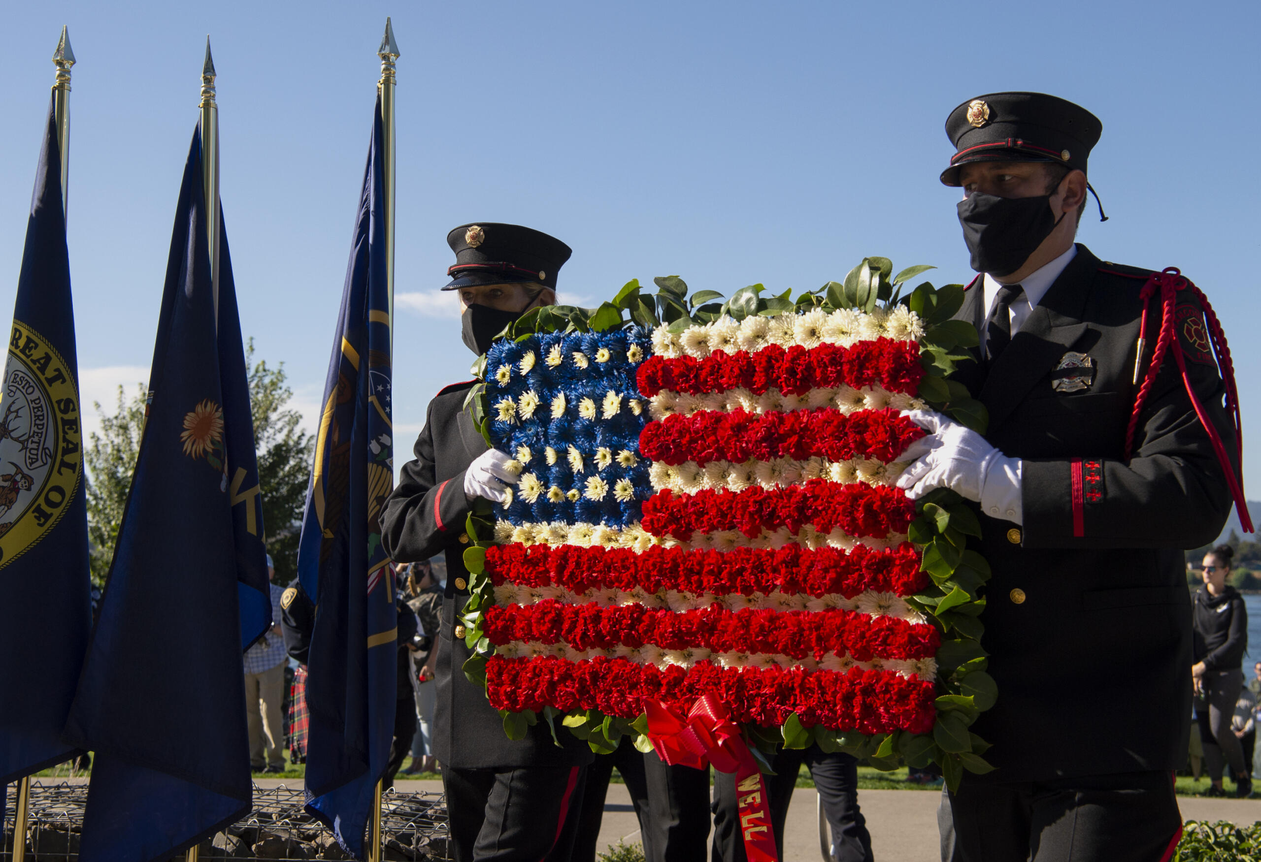 Members of the Vancouver Fire Department Honor Guard present a wreath during the 9/11 Remembrance Ceremony on Saturday, Sept. 11, 2021, at Waterfront Park in downtown Vancouver.