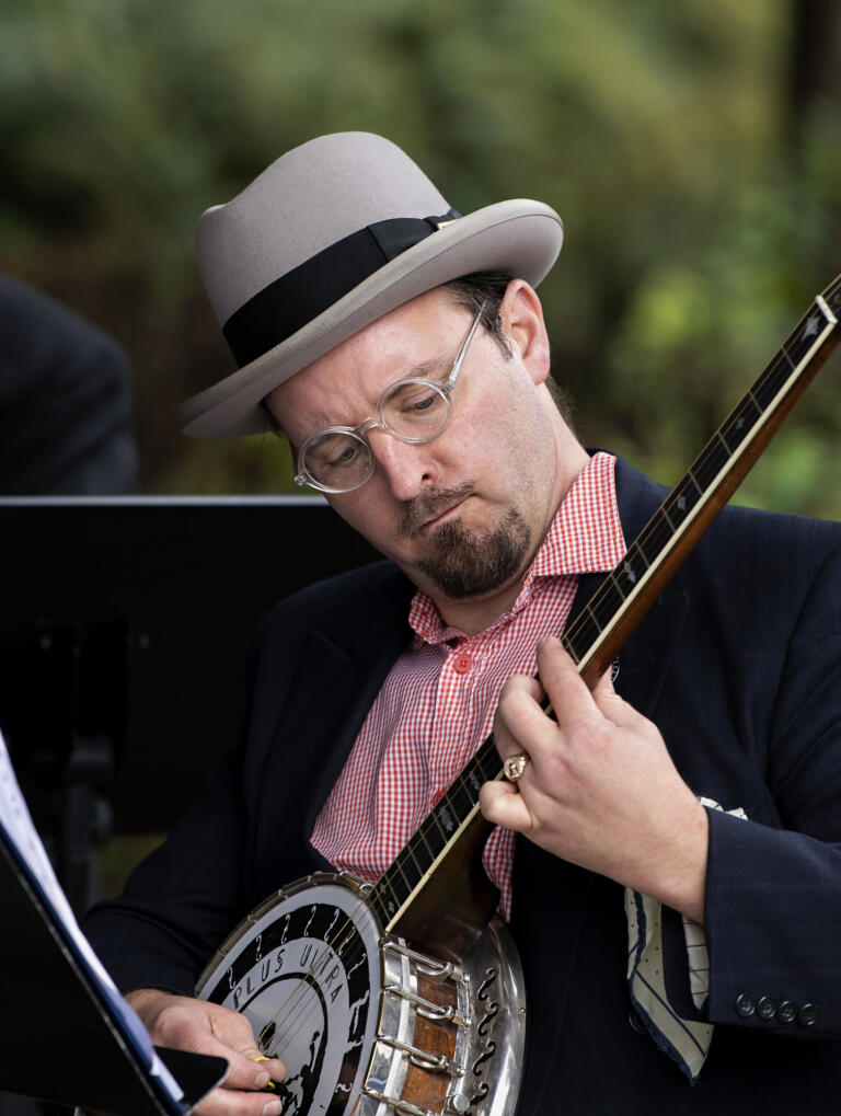 A member of Ne Plus Ultra Jazz Orchestra plays the banjo at the Arts Alive! event on Saturday, Sept. 18, 2021, at the Public Service Center Plaza in downtown Vancouver.