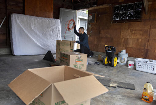 Raoul Campbell-Rouzan of Vancouver packs up his garage while gearing up for his upcoming move to Arizona on Friday morning. A record number of people are quitting their jobs during the pandemic.