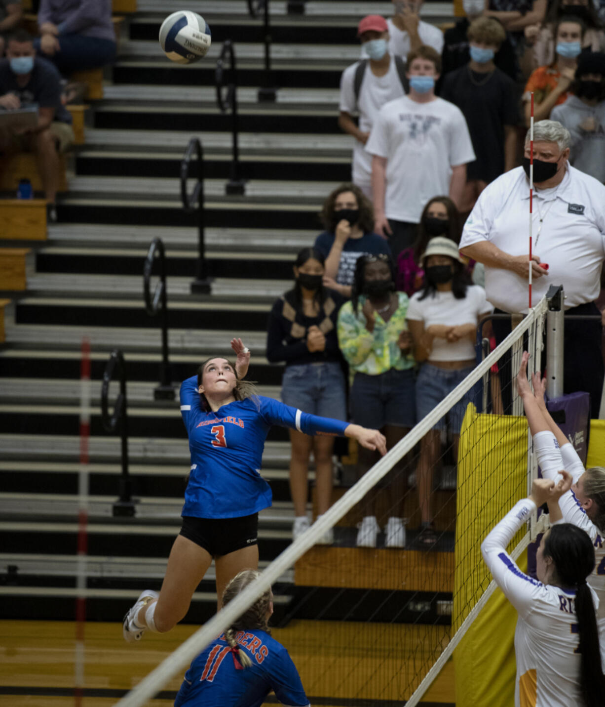 Ridgefield junior hitter Paige Stepaniuk loads up for an attack during the 2A Greater St. Helens League volleyball match on Tuesday at Columbia River High School. The Spudders won 3-0.