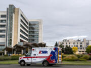 An ambulance passes PeaceHealth Southwest Medical Center on Wednesday.