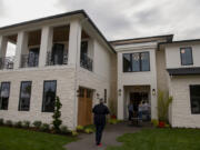 Guests file into a home at the Northwest Natural Parade of Homes on Wednesday in Felida. Some of the featured homes this year include Hardie Textured Panels, a new type of exterior siding that mimics the texture of stucco rather than wood.