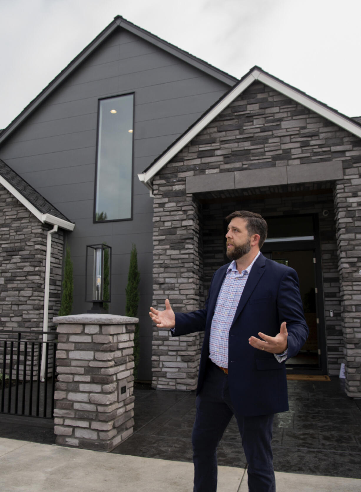Russell Mistich, a James Hardie new product commercialization manager, discusses the new siding present on multiple homes at the Northwest Natural Parade of Homes on Wednesday.