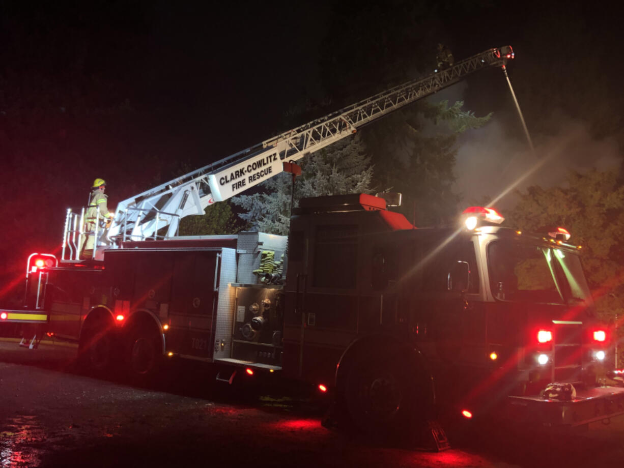 Firefighters battle a Sunday night fire that destroyed a Ridgefield house. The fire was caused by a portable heater in a bedroom, according to the Clark County Fire Marshal's Office.