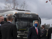 Guests wear masks as they gather near C-Tran buses at the Mill Plain Bus Rapid Transit groundbreaking event Tuesday afternoon. The $50 million project will add Clark County's second bus rapid transit line following the Vine, which debuted in 2017.