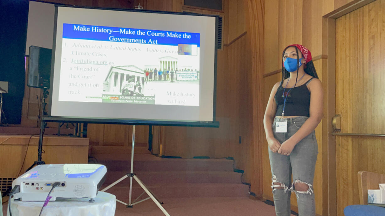 Gracie Taylor makes a presentation to an audience including Port of Vancouver Commissioner Eric LaBrant during a recent Youth Acting for our Earth training.