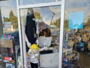 A window is smashed at Vancouver boutique LiquidNation Liquidators. Owner Jullienne Adams arrived at her store Wednesday morning to find the glass shattered and $3,000 worth of merchandise stolen.