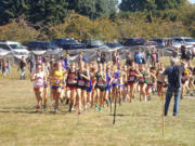 Runners in the Division I girls race take off on the course at Blue Lake Park at the Nike Portland XC meet on Saturday, Sept.