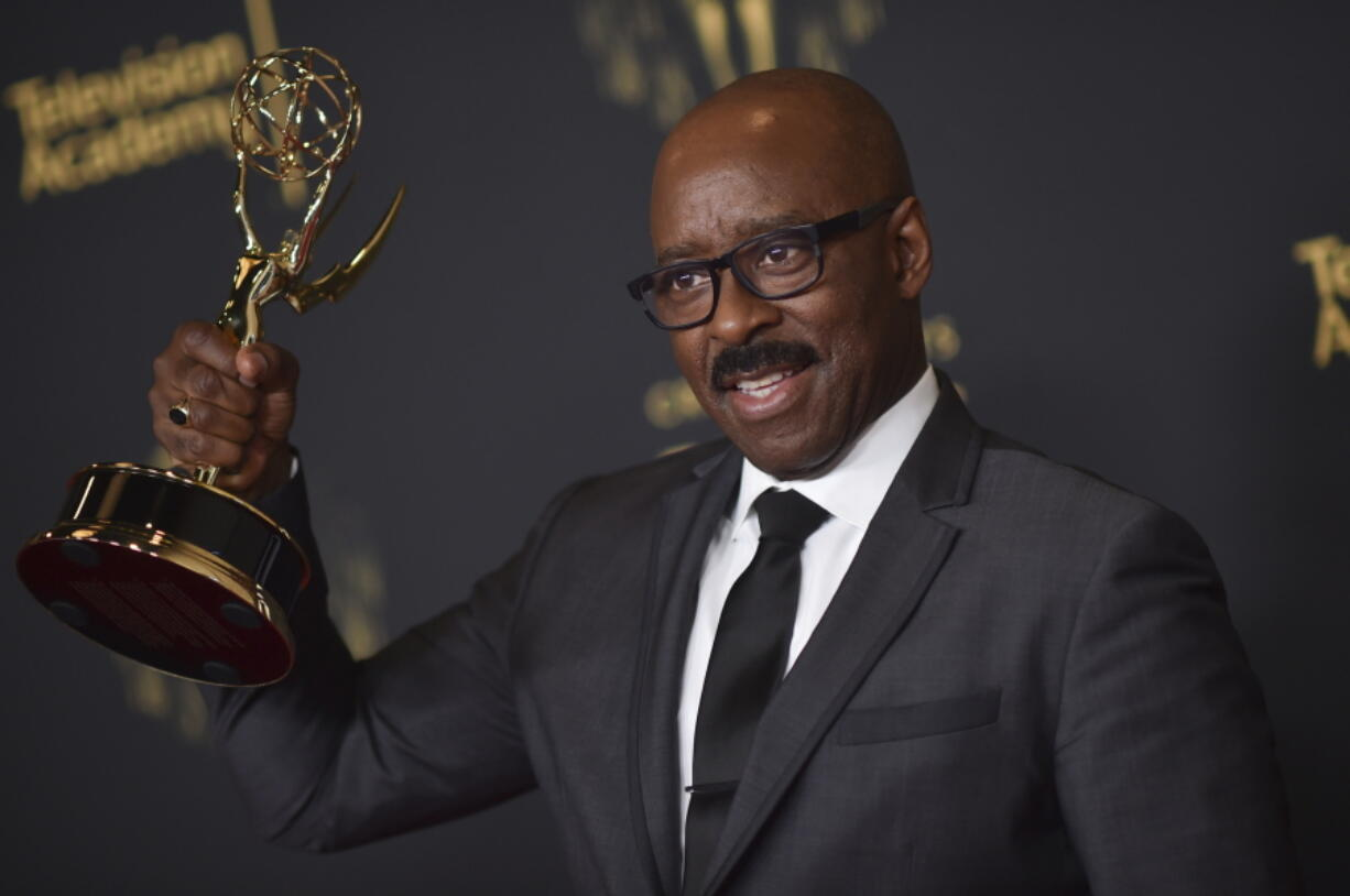 """Courtney B. Vance poses with the award for outstanding guest actor in a drama series for """"Lovecraft Country"""" on night two of the Creative Arts Emmy Awards on Sunday, Sept. 12, 2021, in Los Angeles."""