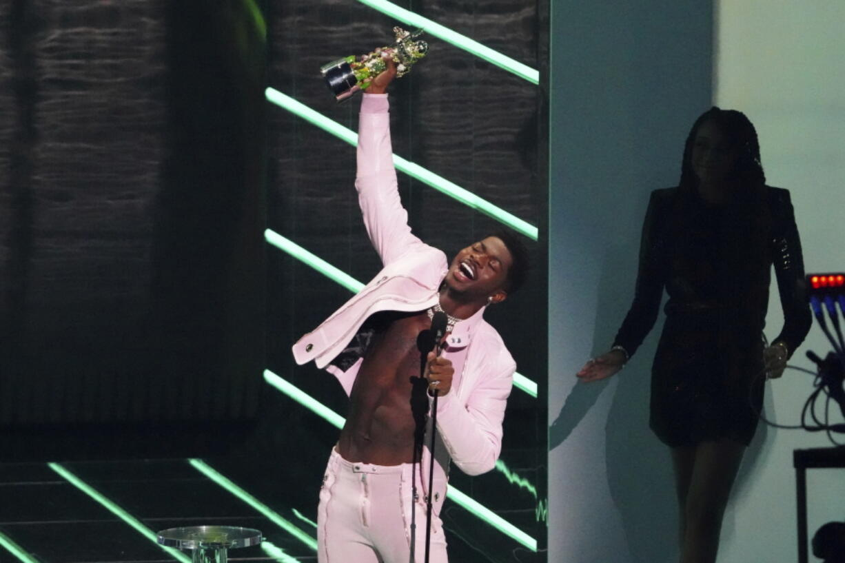 """Lil Nas X accepts the award for video of the year for """"Montero (Call Me By Your Name)"""" at the MTV Video Music Awards at Barclays Center on Sunday, Sept. 12, 2021, in New York."""
