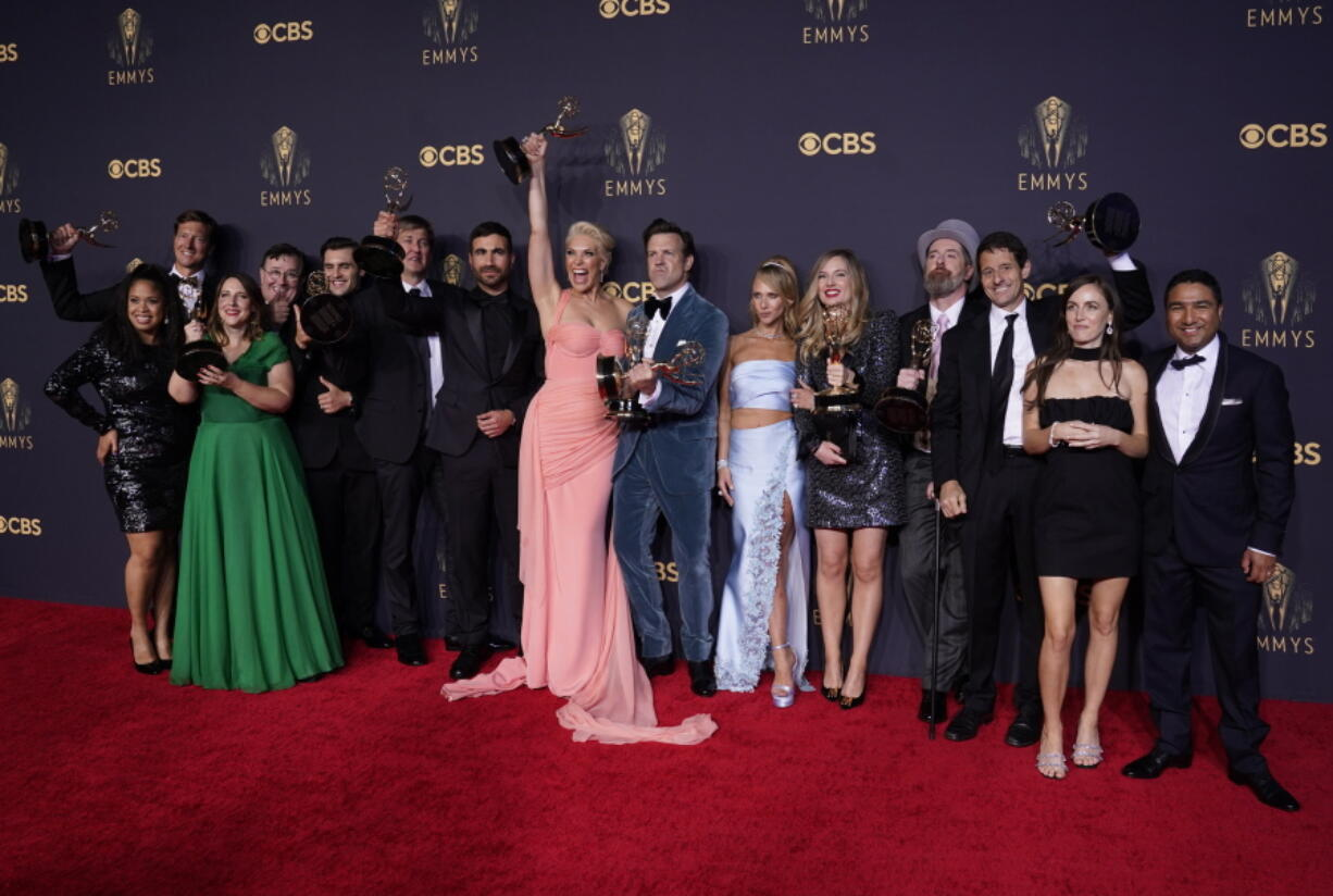 """Brett Goldstein, Hannah Waddingham, Jason Sudeikis, Juno Temple and the cast and crew from """"Ted Lasso"""" pose with their awards for outstanding supporting actor in a comedy series, outstanding supporting actress in a comedy series, outstanding lead actor in a comedy series and outstanding comedy series at the 73rd Primetime Emmy Awards on Sunday, Sept. 19, 2021, at L.A. Live in Los Angeles."""