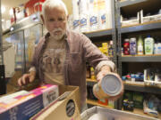 Jerry West fills an order at Martha's Pantry, the area's only food bank aimed specifically at people with HIV/AIDS on Oct. 24, 2013. West, who was instrumental in the charity's founding, died Tuesday at age 84 after battling an infection.