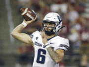 Utah State quarterback Andrew Peasley throws a pass during the first half of the team's NCAA college football game against Washington State, Saturday, Sept. 4, 2021, in Pullman, Wash.