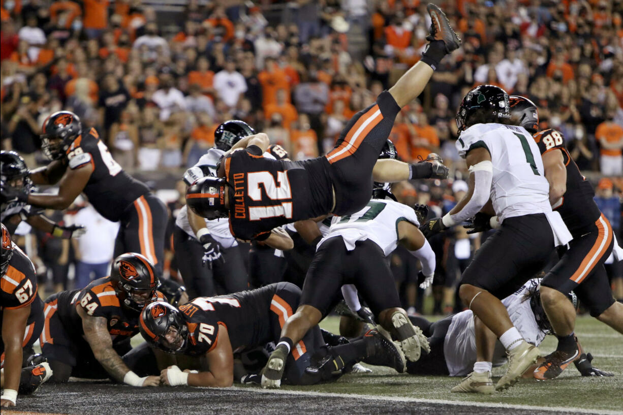 Oregon State inside linebacker Jack Colletto (12) flies backwards into the end zone for a touchdown during the first half of an NCAA college football game against Hawaii Saturday, Sept. 11, 2021, in Corvallis, Ore.