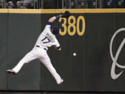 Seattle Mariners right fielder Mitch Haniger can't catch a deep fly ball that fell in for a triple by Boston Red Sox's Xander Bogaerts during the eighth inning of a baseball game Tuesday, Sept. 14, 2021, in Seattle.