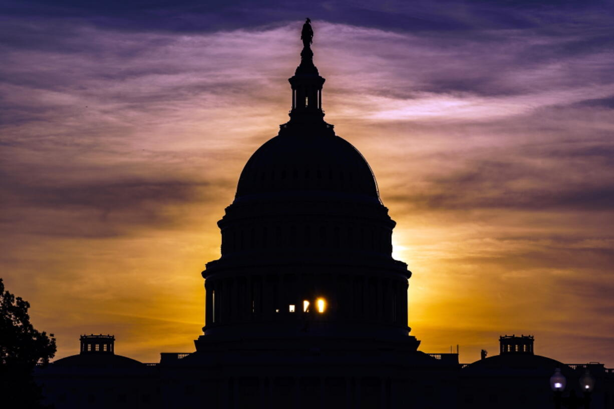 The sun rises behind the Capitol in Washington, Wednesday, Sept. 15, 2021. (AP Photo/J.